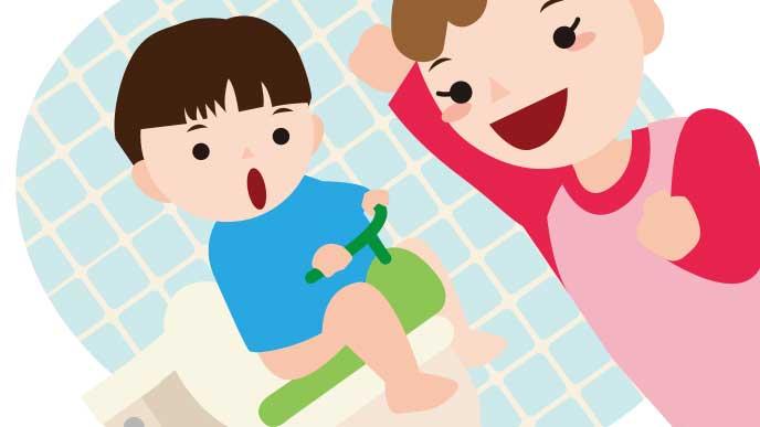 トイレに座れた男の子を見て喜んでいるママのイラスト