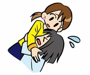 泣く園児を抱く先生