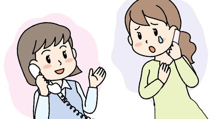 電話相談を受けるNPOスタッフ