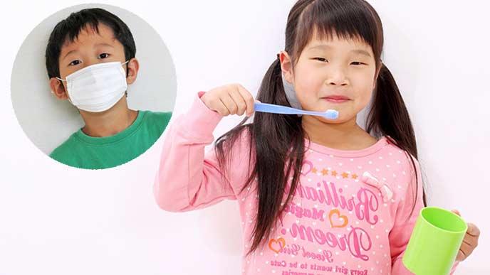 歯磨きする女の子とマスクする男の子