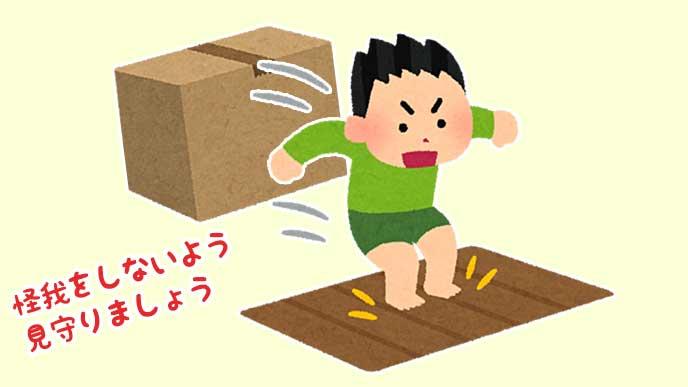 段ボール箱を飛び越える男の子のイラスト