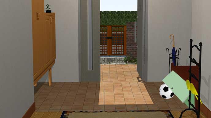 玄関のボックスの中にボールを入れる