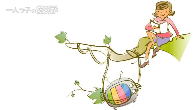 木の上で本を読む女の子