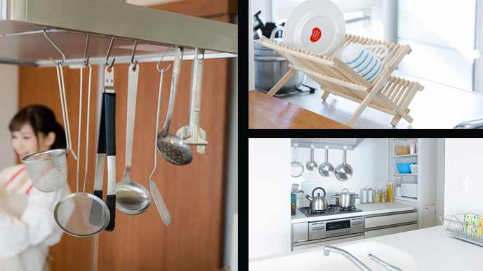 台所の吊るされた調理器具と立てられた皿